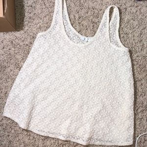 Delia's cream tank top with flower shaped pattern